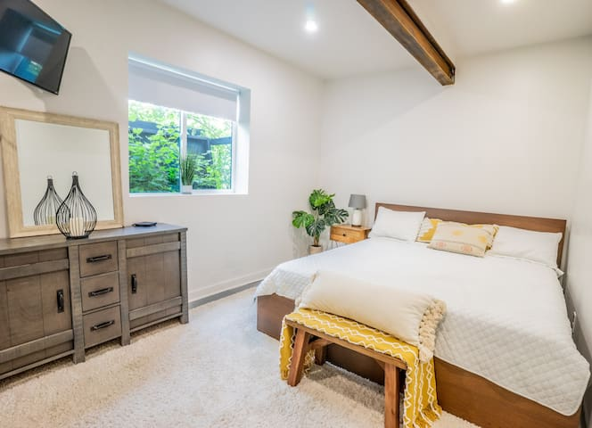 This lush main bedroom features a kind size bed and ample plush pillows for ultimate relaxation.