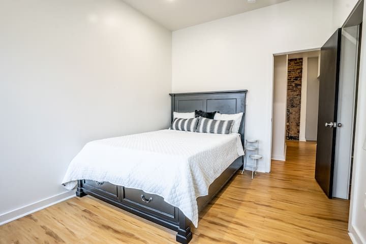 Second bedroom features a city view and a memory foam mattress.