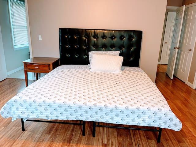 King size primary bedroom.
