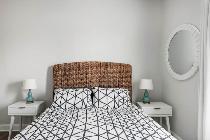 Secondary bedroom features a queen sized bed.