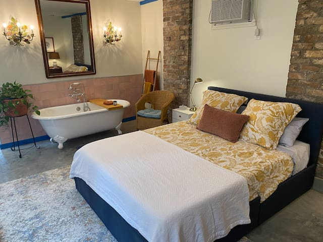 Get some relaxation while you are in New Orleans with a comfy queen bed and a romantic clawfoot tub.