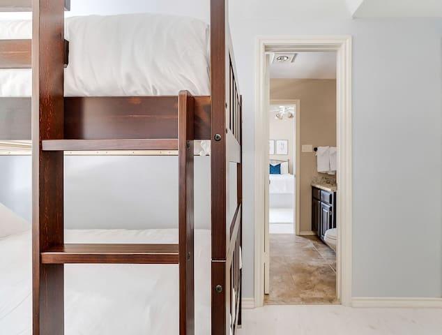 En suite bathroom from bunkroom shared with queen guestroom