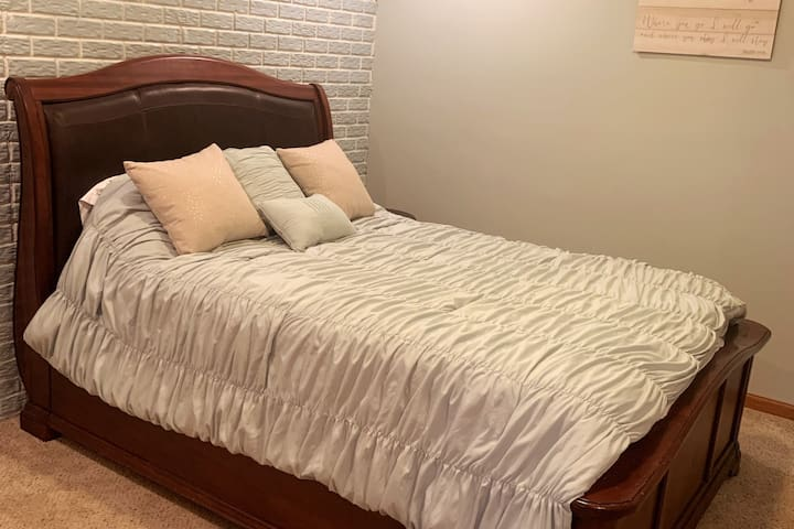 Bedroom 2, queen size bed, soft relaxing decor, large closet.