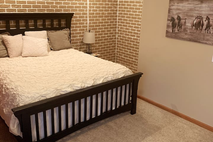 Bedroom 1, country decor, very large room with a king size bed and large closet.