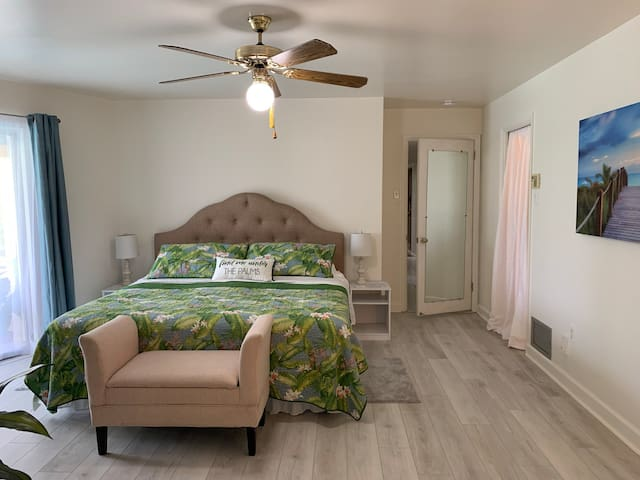 Master Bedroom: Comfortable King bed. 100% cotton Tommy Bahama bedding. Sliding doors to lanai. Walk-in closet. Full bathroom. 50 inch Smart TV. Bedside lighting. Dressers. Upholstered bench. Ceiling fans in every room.