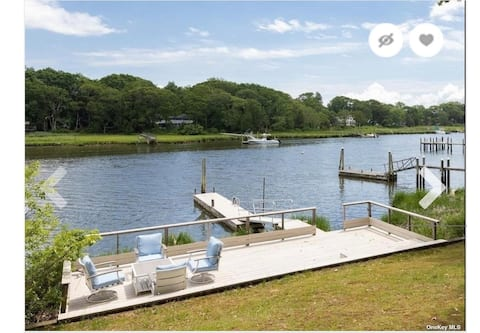 Country cottage, serene waterfront with boat dock.