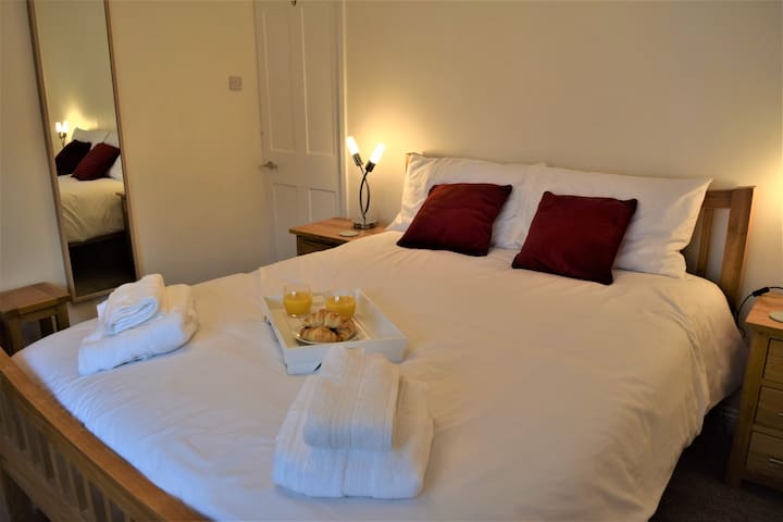 Spacious south facing master bedroom with King size bed, dressing table and large wardrobe.