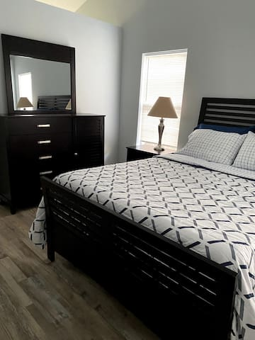 Master bedroom with double closets and comfy bed.