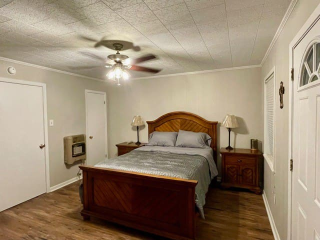 Large spacious bedroom hosting a queen size bed,  walk in closet, and a Dresser for storage. A luggage rack, and air mattress are also available.
