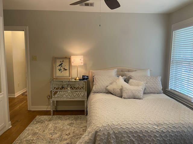 Spacious first bedroom with queen sized bed.