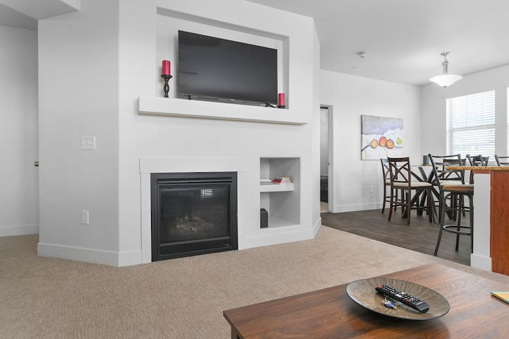 """Nice and spacious living room with a 55"""" Smart TV."""