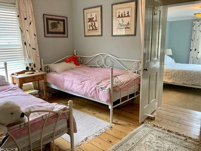 Single beds also available for use with the double room at a £10 extra charge per bed Curtains draw across when in use !