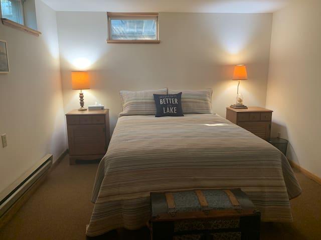 Downstairs queen bed, medium firmness new mattress.