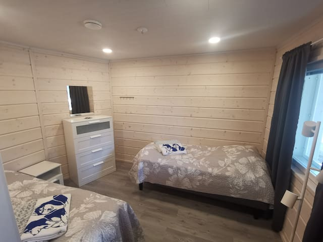 Bedroom 1. All bedrooms have two comfortable quality single beds (90x200), large chest of drawers, mirror, hanger, bedside table, reading light and armchair. In addition, all windows have blinds and blackout curtains.