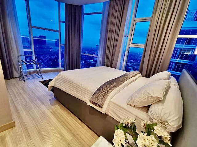 Master bedroom with 180degree view of the city
