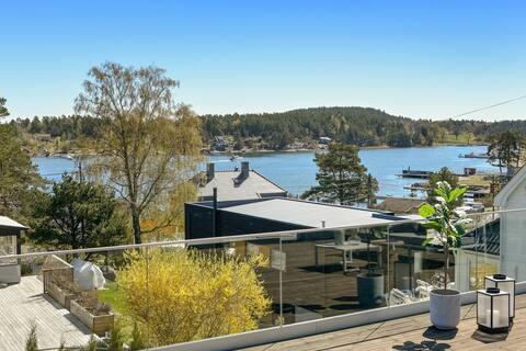 Modernes Ferienhaus mit Meerblick und Dachterrasse