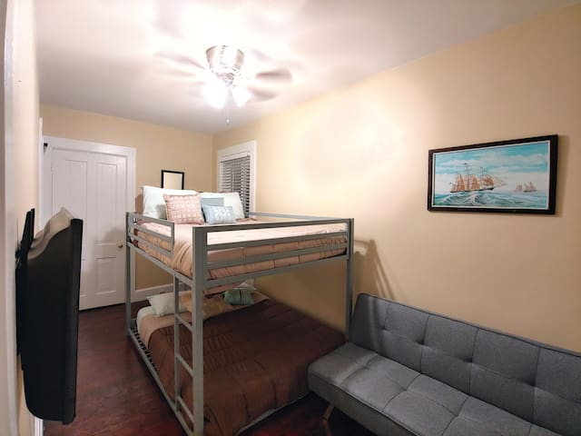 Bedroom 2 with full bunk beds and sofa sleeper