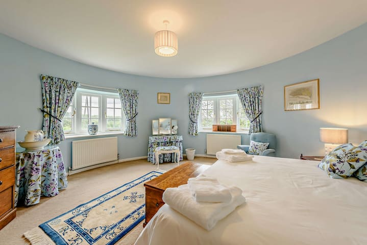 The Indian Ocean Room - an enchanting ensuite round bedroom in the second Oast, with stunning views out over the valley, as well as a spectacular cherry blossom in bloom in the spring.