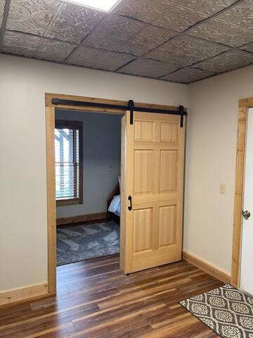 ground floor: bunk room with barn door
