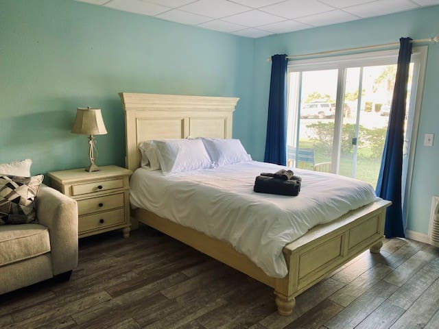 Queen size bed with luxury white linens and down comforter.  Each guest is provided with Luxury towels & washcloths.