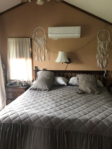 King size bed with air conditioner. Room has an outside balcony as well as access to a third floor deck overlooking the water.