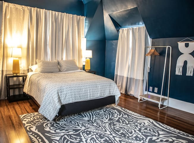 The master bedroom comes with a queen mattress. The entrance to the bathroom that has the shower is located in the master bedroom.   There is a half bath located near the kitchen area.