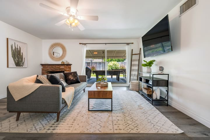 Bright and airy living room space with workspace available with new double pane sliders that lead to an entertaining backyard