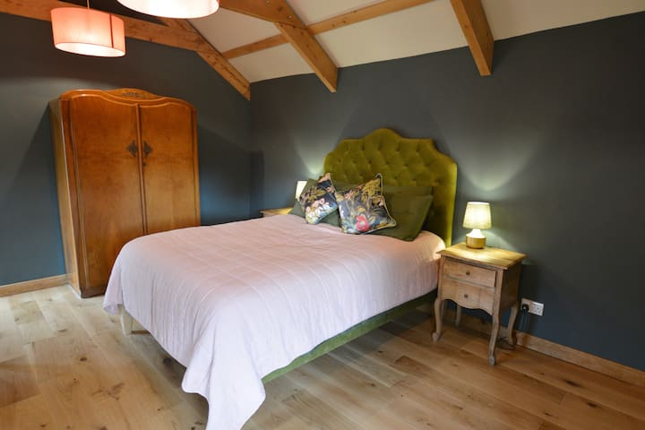 The master bedroom has a king size bed and large en-suite bathroom