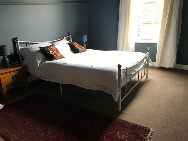 The main bedroom - a comfy king size bed. Each room has a clothes rail and hangers.