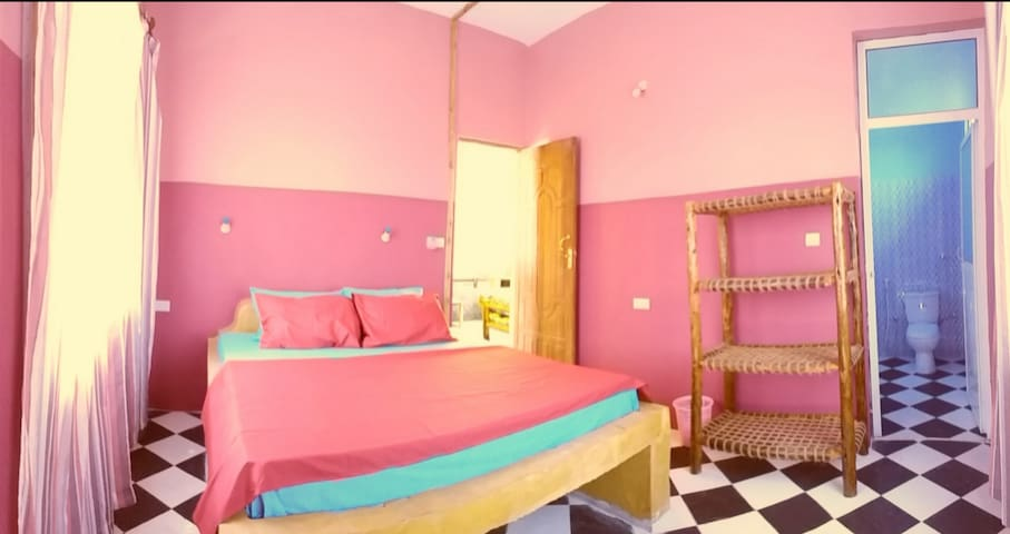 LA LOCANDA LODGE - PINK ROOM  (400 cm x 350 cm) 1 King size bed (190 cm x 190 cm) mosquito net 2 windows overlooking the village ceiling fan private bathroom private balcony overlooking the village