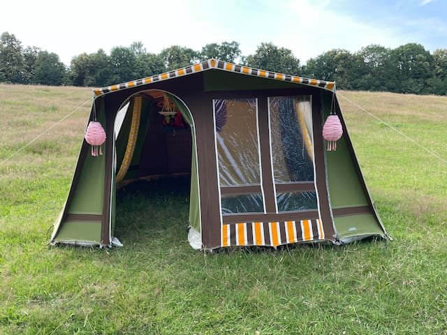 A bedroom tent with 2 extra inflatable beds