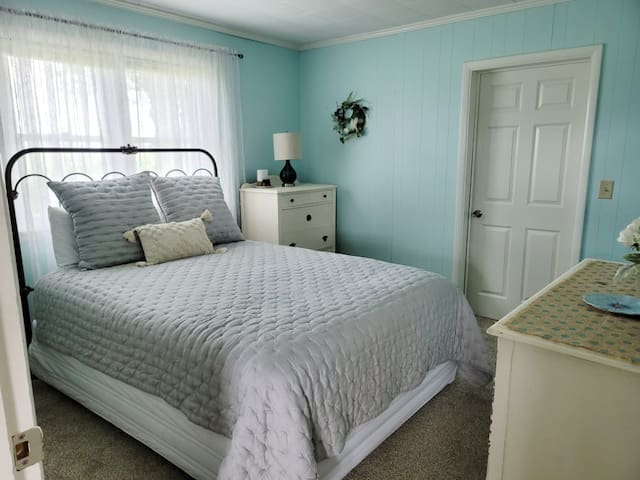 Downstairs bedroom with queen bed, dresser and chest of drawers.  Full size closet.  Black out blinds in all sleeping areas.