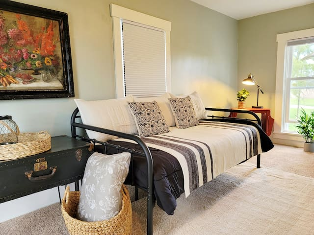 """The second room upstairs is a """"bonus"""".  Out fitted with a daybed (twin sized mattress) is great for a cozy place to read, relax or nap after a day of exploring the Muncie area.  1 person could sleep the night away here."""