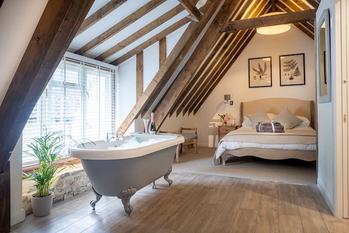 Master bedroom with beautiful roll topped bath.