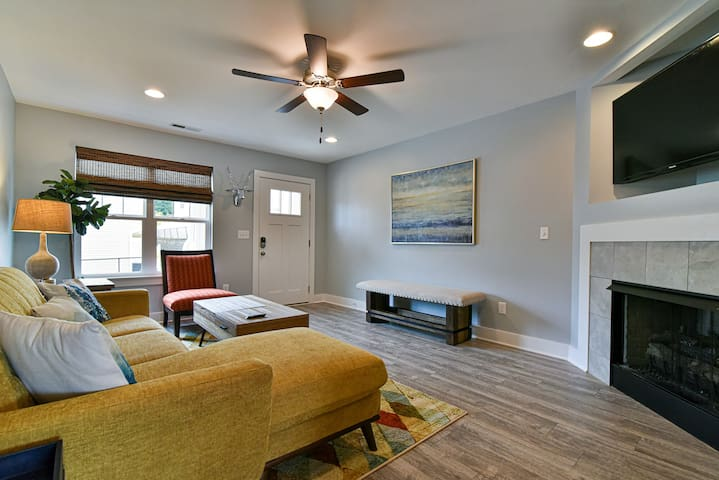 Bright living room with plenty of seating, large flat screen TV, gas log fireplace (available October-March)