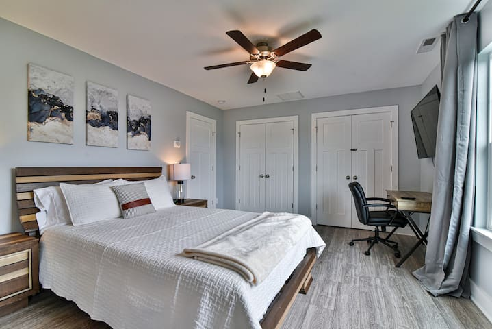 Master bedroom upstairs with queen size bed, large flat screen TV, desk and chair for when you need to do some work from home