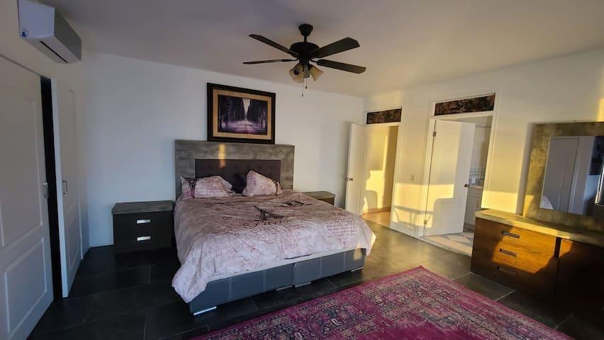 Super suite bed, closet, dresser.