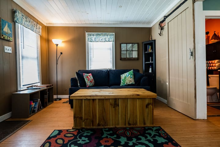 Full-size pull out mattress in couch. Living room converts to private 2nd bedroom with on outside entrance. Custom coffee table contains sheets, blankets n pillows.