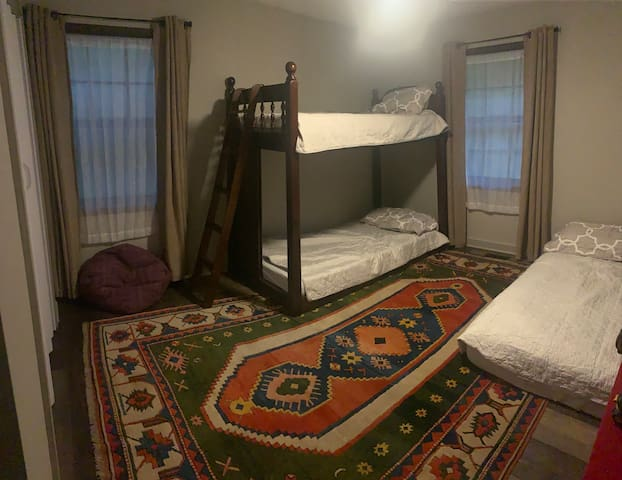 3rd bedroom with twin bunks, small bean bag chair and a cushy queen mattress with foam topper!.