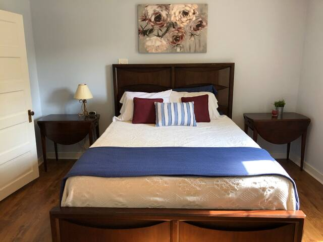bedroom features queen size bed with new matress & box springs.