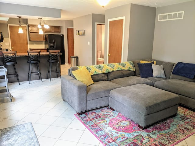 Large TV room with open concept kitchen