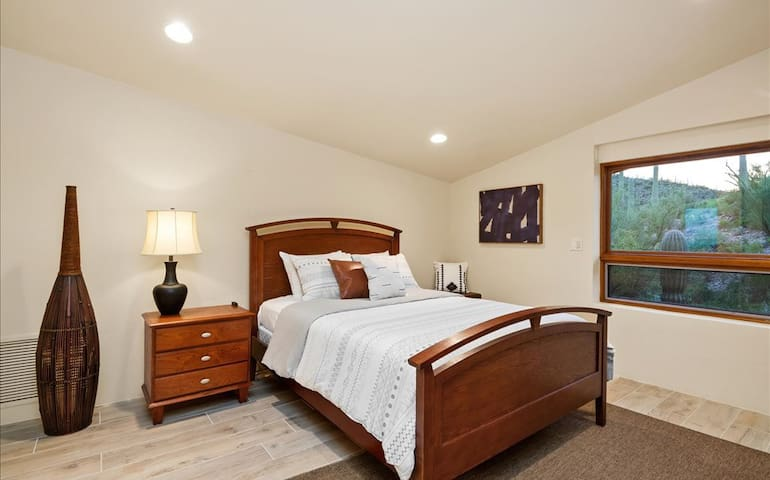 Queen Room 1 located on the top floor with ensuite bathroom. Spectacular views of the mountain side out the window.