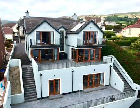 Beautiful, spacious modern home with coastal views