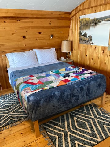 Queen memory foam bed, extra comfortable bedding with handmade quilts .  Local photography wall canvas (available for purchase)