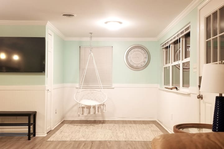 Relax in this comfy indoor swing.