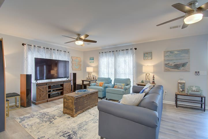 Living Room with a Home Theatre setup and Queen Sleeper sofa