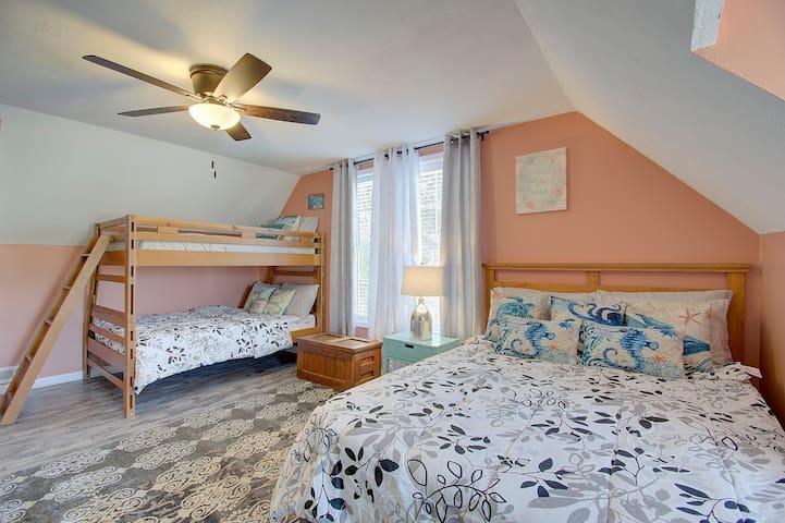 Third Bedroom for the little ones, tweens, and teens. Queen bed and Twin over Full Bunk beds.