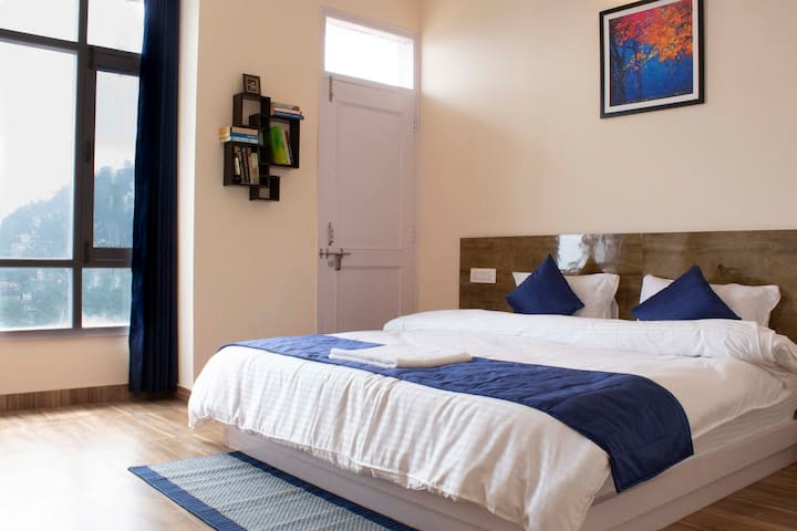 Comfortable bedding with splendid valley view. (Bedroom no. 2)