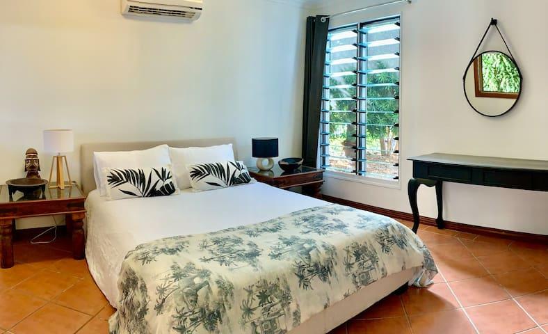Spacious main bedroom with luxury linen
