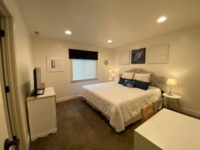 "King memory foam bed, desk workstation, closet, dresser & 40"" TV. Has a door to access the bathroom"